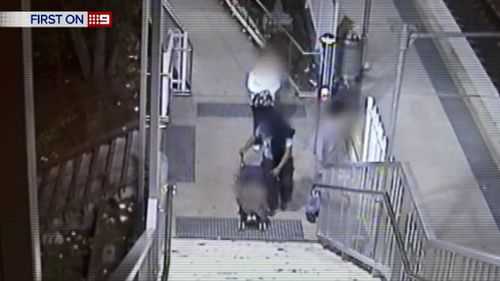 Parents bring young child along for Sydney train station robbery