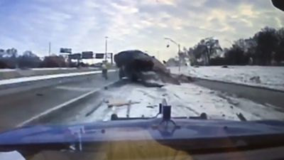 Tow truck driver narrowly escapes icy crash