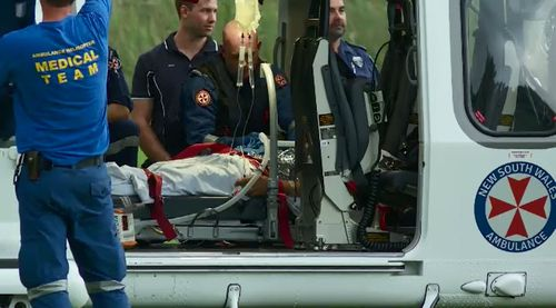 A 52-year-old man was airlifted to hospital in a serious condition from Stanwell Park Beach, south of Sydney, after crashing his hang glider (Supplied).