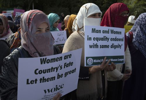In this March 8, 2020 file photo Activists of the Pakistani religious party Minhaj-ul-Quran observe International Women's Day at a rally in Islamabad, Pakistan.