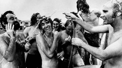 Some mates cool off in the streets after the cyclone. (AAP)
