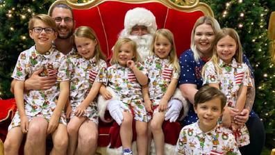 Krechelle with her husband and six children Christmas photo.