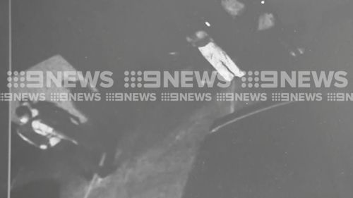 CCTV captures the aftermath of the incident in Kingsgrove, and Aysha (in white trousers) talking to police.