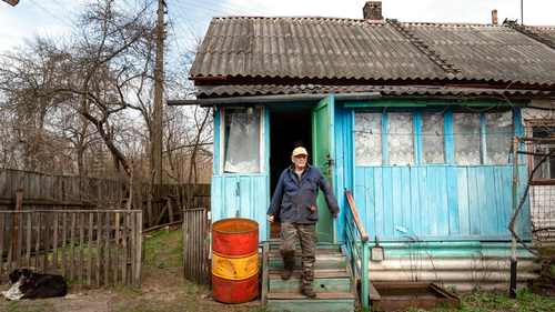 Yevgeny Markevich, a 85-year-old former teacher, leaves his house at the Chernobyl exclusion zone.