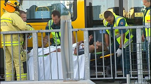 QFR crews had to lift the tram off the man to free him. (9NEWS)