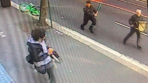 CCTV shows the moment the knife-wielding man was approached by another with an axe, and a chair.