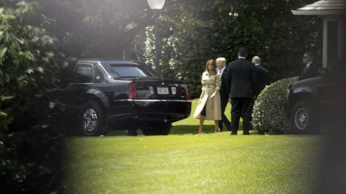 Melania and Donald Trump in her first sighting in nearly a month. (AP)