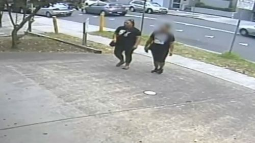 The woman is allegedly walking with Analosa Ah Keni, who was charged with Mr Ledinh's murder in March. (NSW Police)