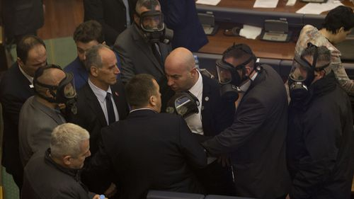 Police also entered the Kosovo parliament following the attack to extinguish the tear gas and force a small group of opposition lawmakers from the room. Picture: AAP.