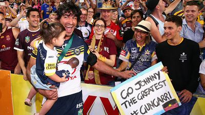 Johnathan Thurston celebrating with fans after the game. (Getty)