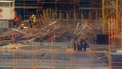 Scaffolding on the site collapsed under extra weight.