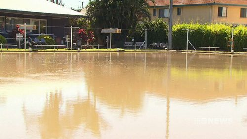 A burst water main in Brisbane's south has sent a raging torrent of water through a home and local bowling club. Picture: 9NEWS.