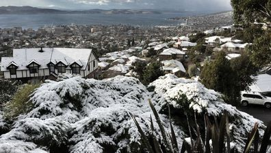 IN PICTURES: Hobart wakes up to first major snowfall in almost 30 years (Gallery)