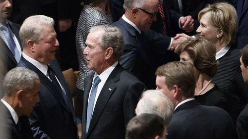 George W Bush chatting to Al Gore