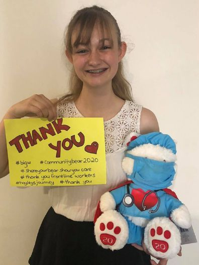 Hayley with bear and thank you sign