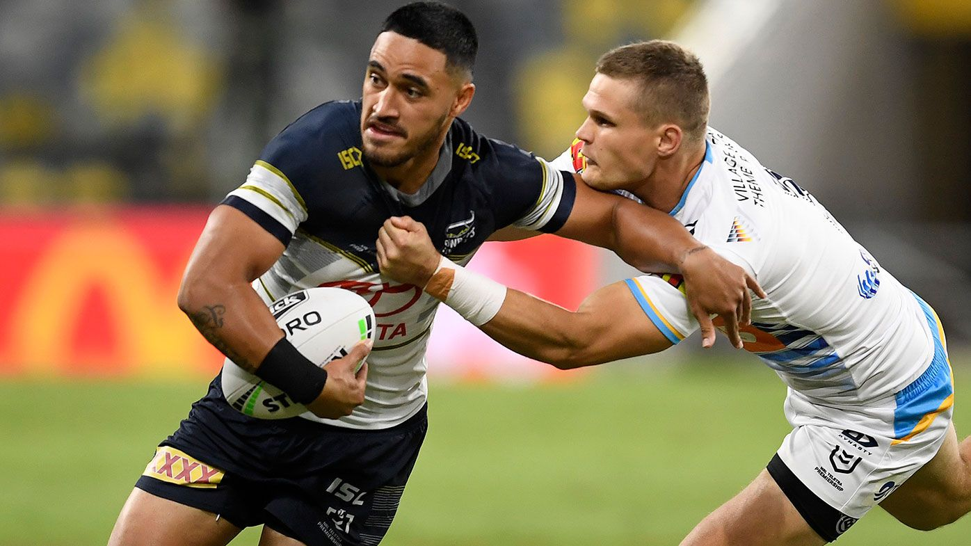Valentine Holmes of the Cowboys is tackled during the round three NRL match between the North Queensland Cowboys and the Gold Coast Titans