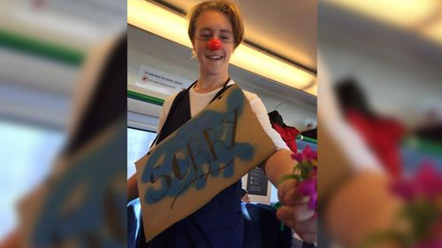 Creepy clown puts on a happy face and makes amends with Melbourne train passengers