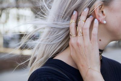 For those of us who find statement jewellery a little too much, the delicate, barely-there trend of the last few years has been a godsend. From tiny bands to the subtlest of chains, there's something chic and nonchalant about a hidden gem or the faintest flicker of bling. Click through to shop some of the daintiest bijoux and see how to wear it.