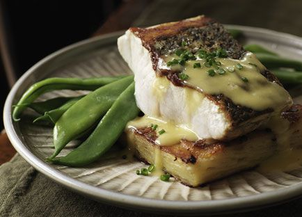 Pan-fried mulloway with potato gratin and leek sauce