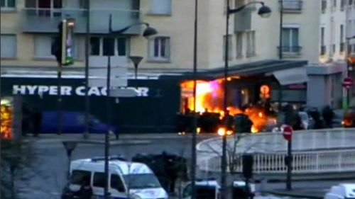 An explosion goes off at the kosher deli in Paris during the police operation. (Supplied)