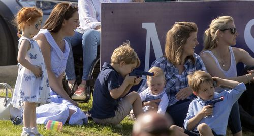 Prince George playing shooting games with a friend. Picture: Getty