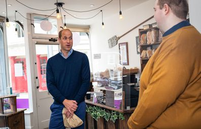 Prince William, Duke of Cambridge speaks to member of staff Ted Bartram during a visit to Smiths the Bakers, in the High Street on June 19, 2020 in King's Lynn, Norfolk