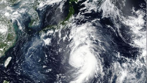 Typhoon Jongdari was heading west along Japan's Pacific coast and was expected to make landfall in central Japan overnight (AAP)