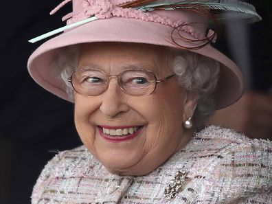 Britain's Queen Elizabeth II smiles as she attends an event at Newbury Racecourse in Newbury England, Friday April 21, 2017.