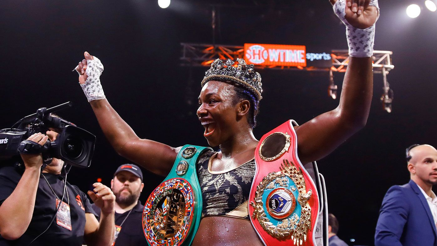 Claressa Shields poses for photographs after defeating Ivana Habazin