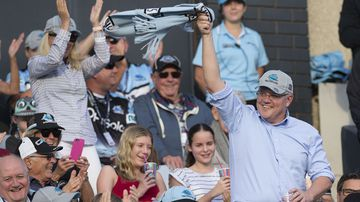 Newly reelected Prime Minister Scott Morrison waves to the crowd during an NRL match between the Cronulla Sharks and the Manly Sea Eagles.