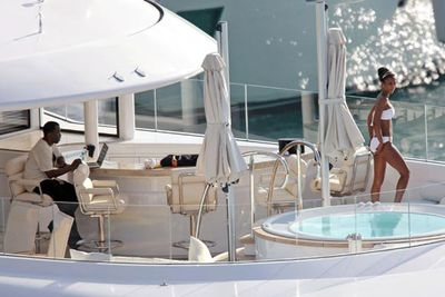 This is the life! Sean 'Diddy' Combs seemed more interested in his laptop than his on/off girlfriend Kim Porter on board his yacht of the coast of the West Indies.