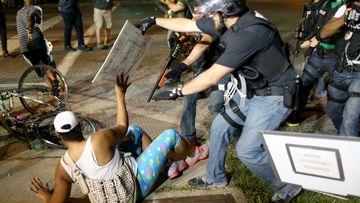 Police officers arrest a demonstrator in Ferguson. (Getty)