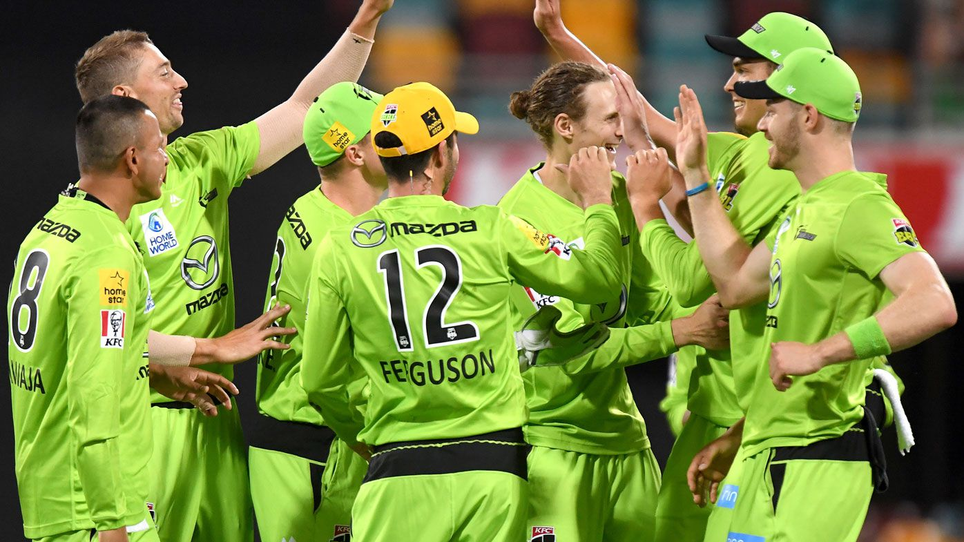 Thunder teammates celebrates after taking a wicket