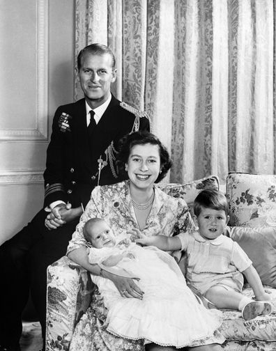 Queen Elizabeth poses for a family portrait with a young Charles and Anne