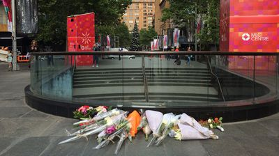 Crowds have converged on Sydney's Martin Place on Tuesday morning to lay flowers for the two hostages who died as a result of the siege which brought the CBD to a standstill. (Supplied)