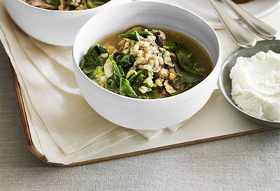 Mushroom and pearl barley broth with goat's curd crostini