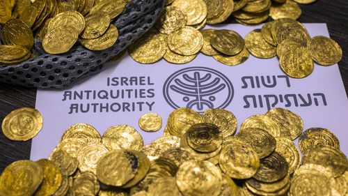 Almost 2,000 gold coins in different denominations were uncovered. (Getty)