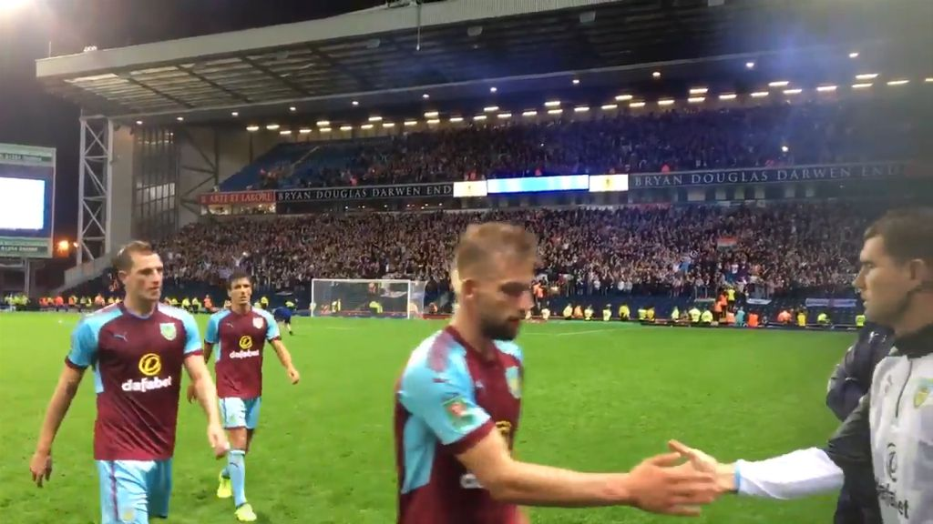 Burnley players leave pitch after fan invasion