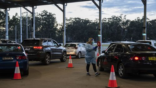 SydPath staff conduct COVID-19 tests at the 24 hour drive through clinic at Fairfield Showgrounds, Sydney.
