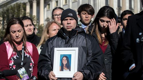 Ilan Alhadeff holds a photograph of his daughter, Alyssa Alhadeff, 14, killed during the shooting at Marjory Stoneman Douglas High School in Parkland, Florida. (AAP)