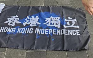 Hong Kong police arrest man for displaying independence flag under new national security law