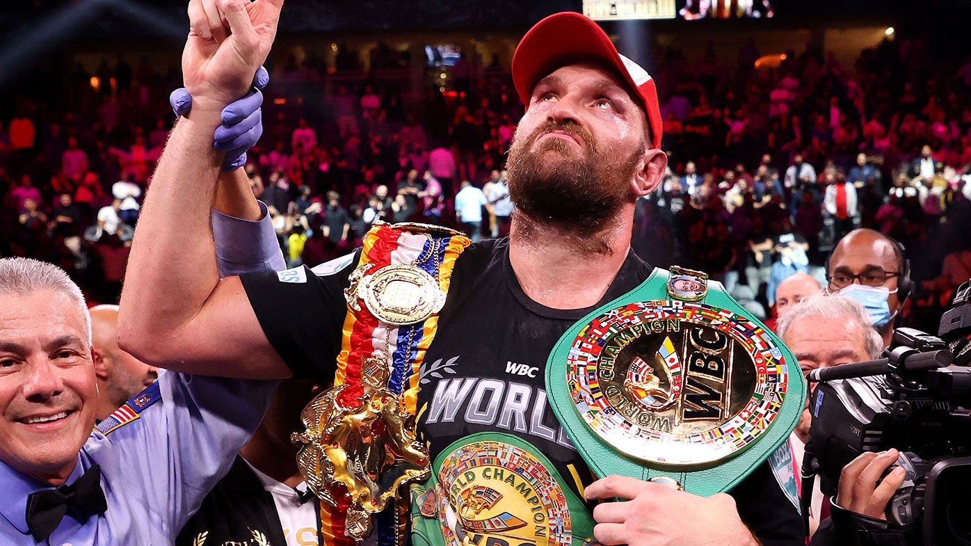 Tyson Fury celebrates his 11th round knock out win against Deontay Wilder after their WBC heavyweight title fight
