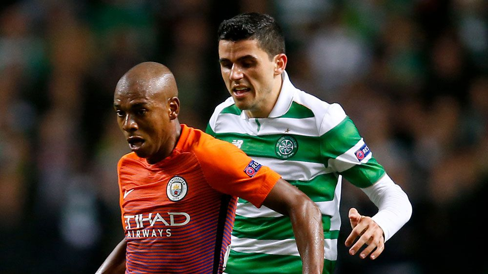 Tom Rogic battles against Manchester City in the Champions League. (AAP)