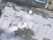 Thick plumes of smoke are seen blowing from the factory's roof.