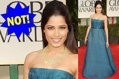 Freida is an absolute stunner but she's totally drowned out in a sea of a blue! Not to mention that cone hair...