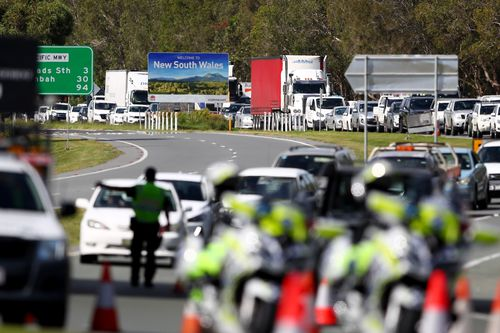 Queensland Police stop vehicles at a checkpoint at the Queensland-New South Wales border in Coolangatta.