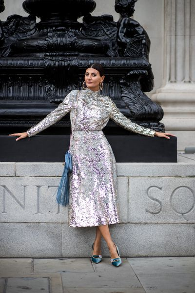 A nipped in waist, long sleeves and the most incredible shimmering fabric for Giovanna Engelbert.