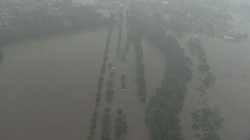 Thousands evacuated as downpours trigger Australia floods
