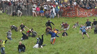 The annual Cheese-Rolling in the UK sees competitors tumble down a steep hill in pursuit of a rolling ball of cheese. It sounds simple enough but the rough terrain adds an element of danger.