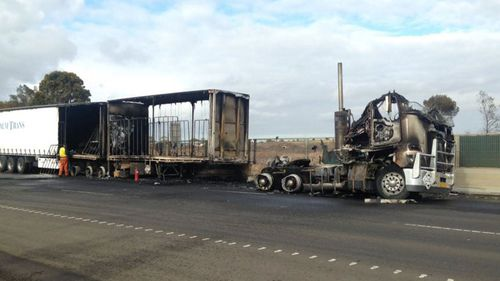 The truck is believed to have hit a concrete barrier, rupturing a fuel tank. (Twitter @Neary_Ty)